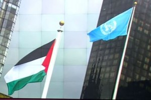 Palestine flag (L) flies along sided the UN's at the UN HQ