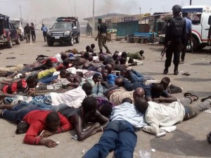 People being held by the Nigerian Police during a deadly fight between the Yoruba and Hausa people in Agiliti, Mile 12, Lagos state on 3 March 2016