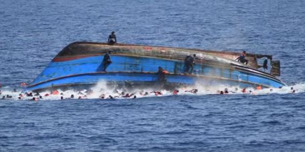 A boat carrying migrants was pictured as it capsized; it overturned seemingly as people on board moved towards one side after spotting a rescue ship, May 2016
