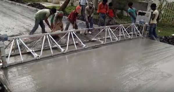 Cement being used in constructing road