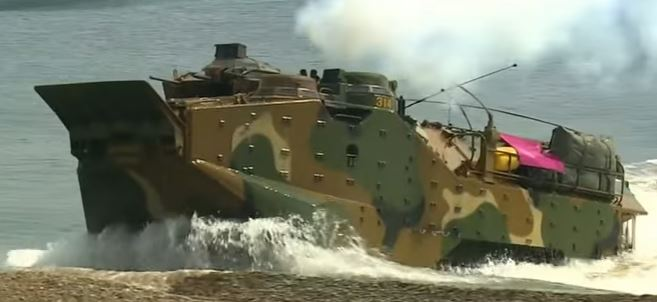 Military tank exiting Sea