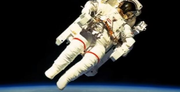 Astronauts working in space