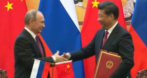 Russian President Vladimir Putin, left, and President of the People's Republic of China Xi Jinping