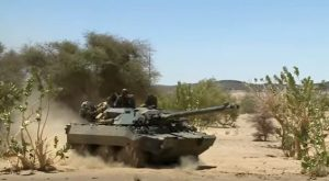 Soldiers riding on Armoured Personnel Carrier