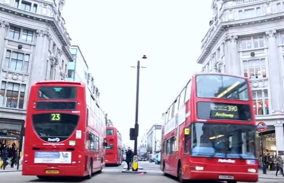 Buses at High street shops in London