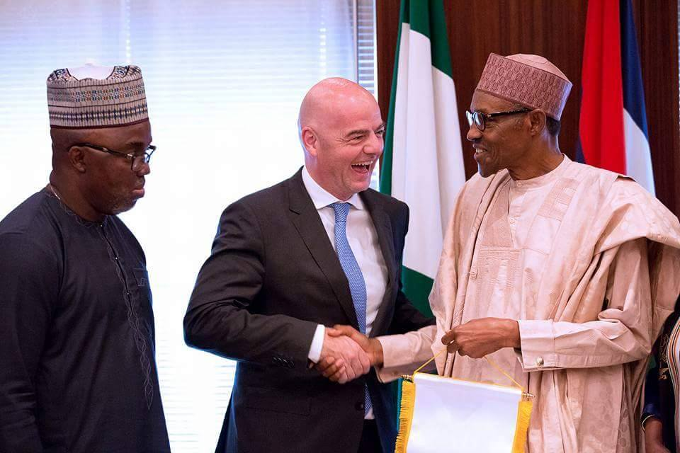 Muhammadu Buhari receives Gianni Infantino (middle) in Abuja, July 2016