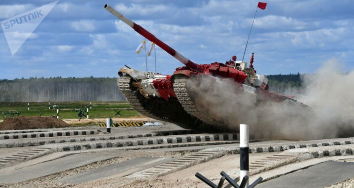 A Russian Army tank crew takes part in a relay race during tank biathlon competitions of the 2017 Int'l Army Games. (Image credit Sputnik/Mikhail Voskresenskiy)