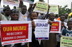 Protesters demand that ailing President Mohammadu Buhari resume work or resign, Aug. 7, 2017. (Credit to Philip Ojisua/AFP via Getty Images)