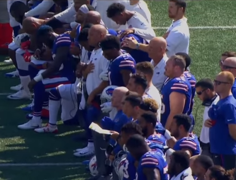 NFL players take a knee to protest