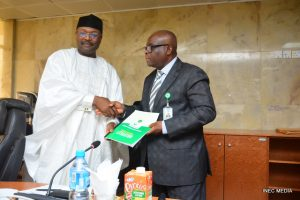 Mahmood Yakubu (left) and Judge Walter Onnoghen. (Photo credit INEC & Basil Nwagugu)