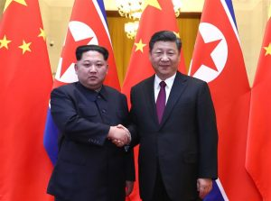 Kim Jong Un (L) and Xi Jinping. (Image credit Xinhua/Ju Peng)