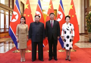 Xi Jinping and his wife Peng Liyuan (R) with Kim Jong Un and his wife Ri Sol Ju (L) at the Great Hall of the People in Beijing, March 2018. (Image credit Twitter/@PDChina)