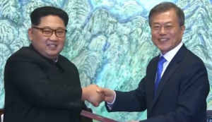 North Korea Leader Kim Jong-Un (L) and South Korean President Moon Jae-In meet in Panmunjom on Friday 27 April 2018