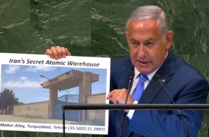 Benjamin Netanyahu displaying a visual document of what he claims is the location of Iranian secret atomic warehouse/site.
