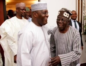 PDP Presidential Candidate Atiku Abubakar (L) and APC Leader Bola Tinubu