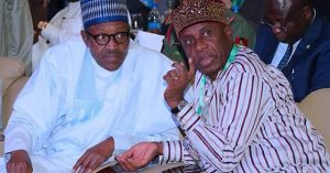 Muhammadu Buhari (L) and Rotimi Amaechi