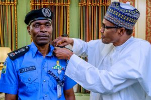 President Muhammadu Buhari decorates the new IGP Abubakar Adamu Mohammed, 15 Jan 2019