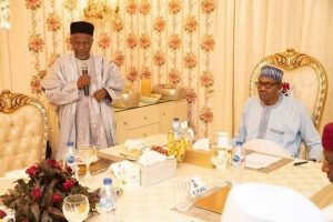 Ibrahim Tanko Mohammed (L) and Muhammadu Buhari in Aso Rock on May 22, breaking Ramadan fast