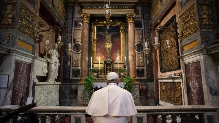 Pope Francis prays before the miraculous crucifix at the church of San Marcello on the Corso (Vatican Media)