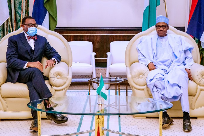 Nigeria's President Muhammadu Buhari (R) and President of the African Development Bank (AfDB), Dr Akinwumi Adesina (L)