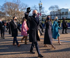 President Joe Biden and First Lady Dr. Jill Biden walk along Pennsylvania Avenue in front of the White House during Inaugural celebrations, Wednesday, Jan. 20, 2021. President Biden was sworn in as as the 46th President of the United States. (Photo by Doug Mills/The New York Times)