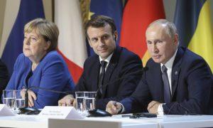 Angela Merkel, Emmanuel Macron, left and centre, have sugggested an EU summit with Russian president Vladimir Putin. Photograph: Ludovic Marin/AP