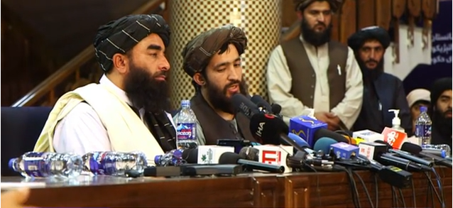 Taliban officials and leaders at a press conference, 18 August 2021
